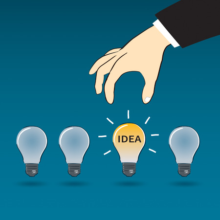 pick light: business hand choose idea light bulb