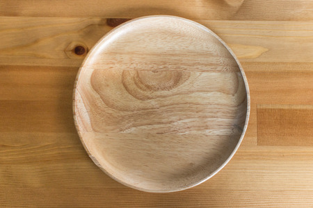 empty table: brown wooden plate on wood table background