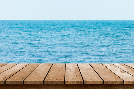 table top: wood table top  with blue sea background