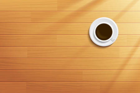 table top: coffee cup on wooden table top view