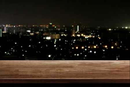wood table top on night city background