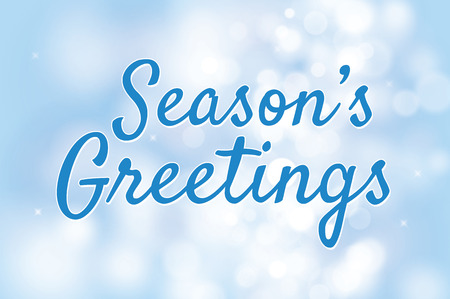 blurry: Seasons greetings with blue bokeh background for christmas theme