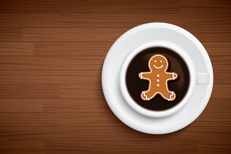 coffee mug with gingerbread man shape on brown wood table