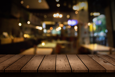 Blur coffee shop or cafe restaurant with abstract bokeh light background. For create montage product display Archivio Fotografico