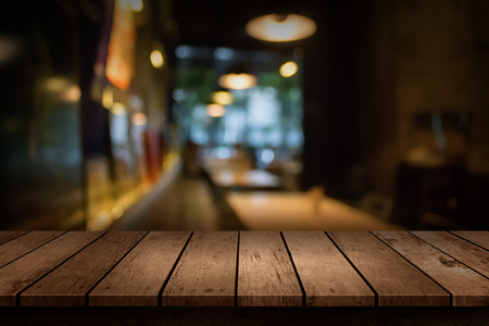 Blur coffee shop or cafe restaurant with abstract bokeh light background. For create montage product display Foto de archivo