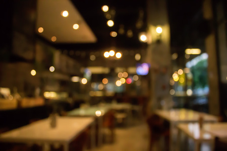 Blur coffee shop or cafe restaurant with abstract bokeh light image background