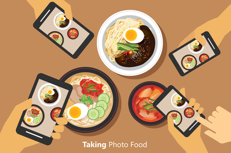 People take a photo of korean food with smartphone