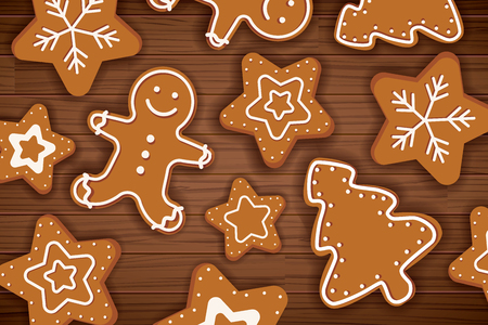 Gingerbread man on wooden table background. Merry christmas holiday card with homemade cookies.