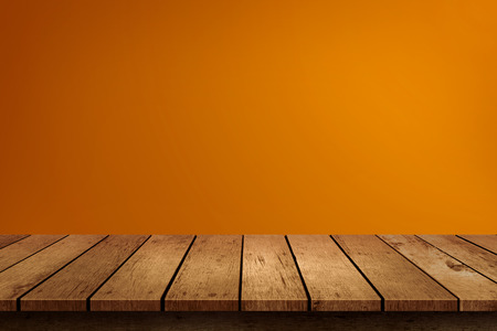 Halloween empty wooden tabletop on orange background. Use for product display montage.