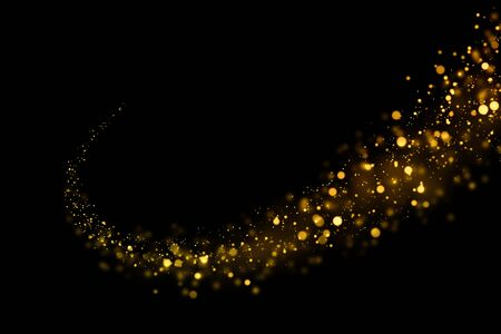 Gold glittering light bokeh abstract particles in dark background. Reklamní fotografie