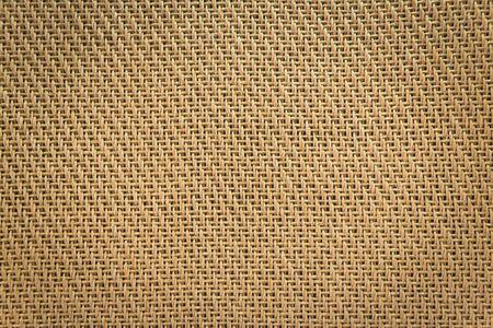 Mesh cloth speaker brown fabric detail of the amplifier. 免版税图像