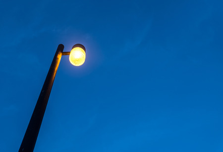 Electric street lamp against twilight background
