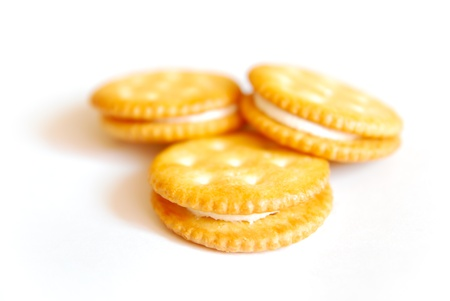 sandwich biscuit with white cream on white background photo
