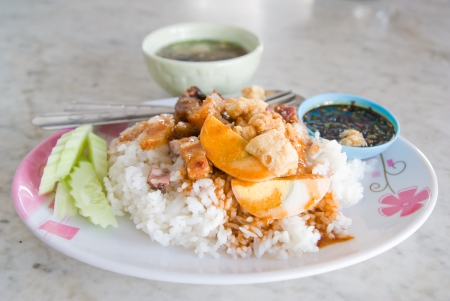 Crispy pork with rice and sauce  photo