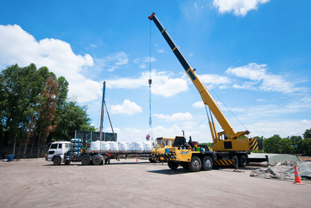 A crane car was loaded on the truck.