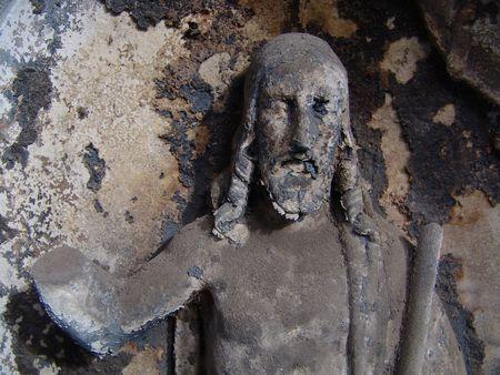 limbless: Ancient dingy limbless Jesus on a old prague cemetery