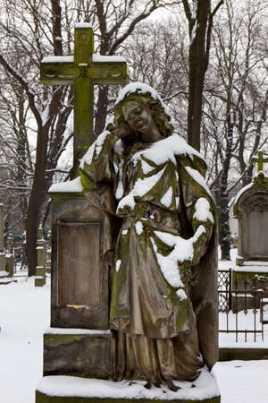 Historic Statue on the mystery old Prague Cemetery, Czech Republic
