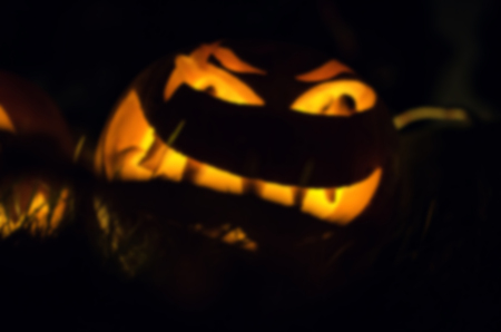 Frightful ghost face glowing on Halloween in the darkness, blur Stock Photo