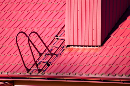New red tiled roof and ladder