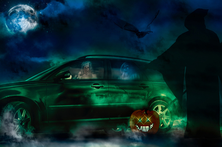 Halloween ghosts driving a new car Stock Photo