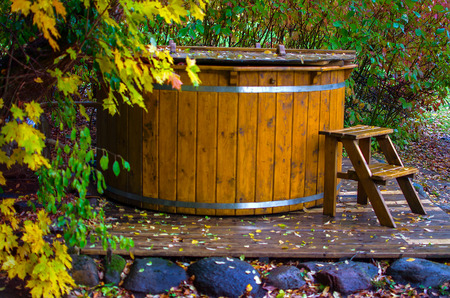 Wooden hot tub with a ladder Stock Photo