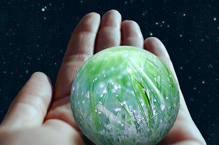 Hand holding a symbolic planet represented by a green nature ecological environment.  Environmentally friendly concept Stok Fotoğraf