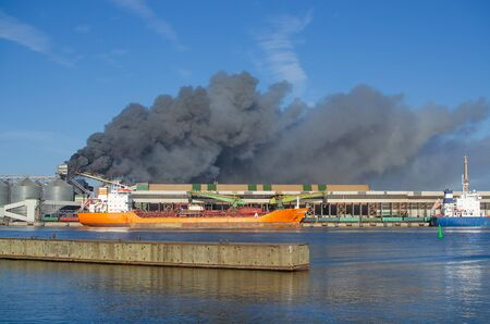 Fire at the industrial zone. Warehouse Fire Smoke at port Stock fotó