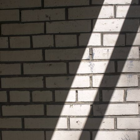 abstract black and white diagonal background white brick wall with sunlight