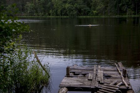Jetty on the lake, in karelia dark forest