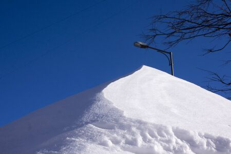 winter snow surface with patterns created by wind and other natural phenomena