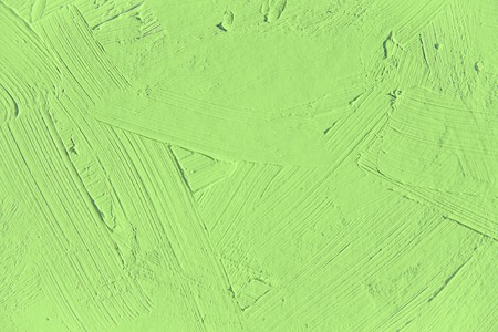 Painting closeup texture.Plain light green color background for vivid, colorful,creative backgrounds. Oil on canvas brush strokes texture. For web and design. 版權商用圖片