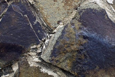 Close up of stone texture, with vibrant colors for creativity, imaginative backgrounds and ideas. Suitable for print, web, postcards, posters, flyers.