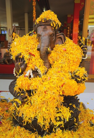 god figure: Ganesh with flower