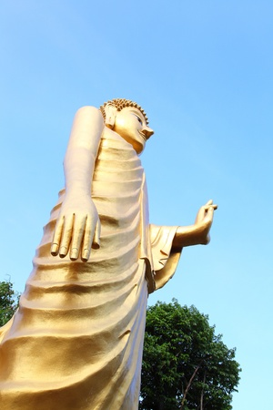 Big stand golden buddha giving mercy