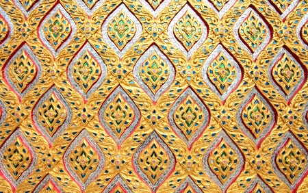 flower pattern in traditional Thai style mosaic on the wall temple