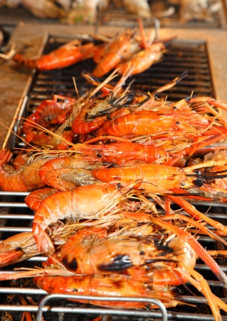 Shrimp are being burned on the grill  photo