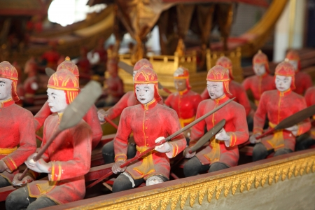 The Thai ancient soldier dolls are paddling on the boat photo