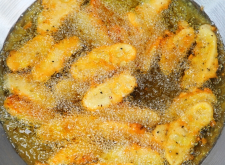 Frying Banana in the pan called  Kruay Tod , the favorite dessert in Thailand   Stock Photo