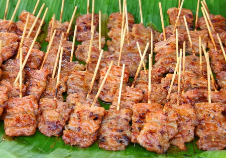Traditional Thai style grilled pork  on the banana leaf photo
