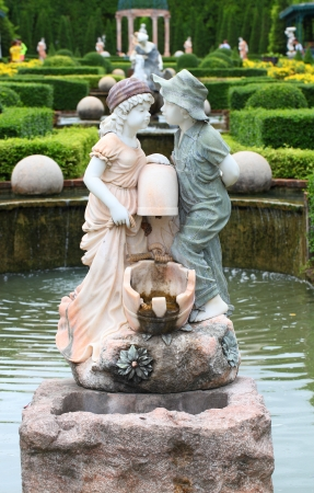 Statue of lovely boy and girl in the public garden   photo