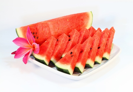 The water melon on dish on white isolated
