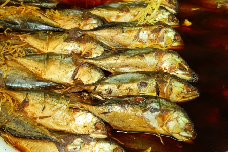 Mackerel fish in deep sauce boiling for Thai native food at Donwai floating market Stock Photo - 14416748
