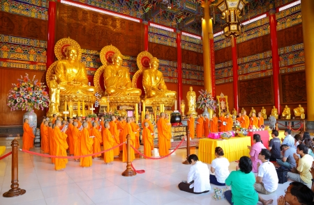 NONTHABURI, THAILAND - AUGUST 5 : Chinese monks and Chinese peoples show great faith by worship and pray to the Buddha in the morning at Leng Ne Yee 2 temple on August 5,2012 in Nonthaburi, Thailand  Editorial