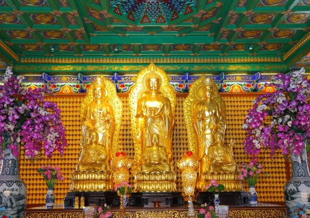 NONTHABURI, THAILAND - AUGUST 5 : The beautiful golden three Buddha are wait for Thai people and tourist who have faith to worship at Leng Noei Yi 2 temple on August 5,2012 in Nonthaburi, Thailand