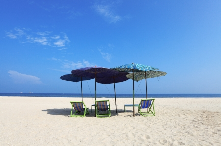 Comfort chairs and umbrella on the beach under the blue sky for background Stock Photo - 15814181