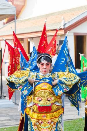 BANGKOK,THAILAND- NOVEMBER 28: Chinese opera dancers was showing the dance on King Taksin day who liberating Siam at Wat Aroonratchawararam temple on December 28,2012 in Bangkok,Thailand  Stock Photo - 18222567
