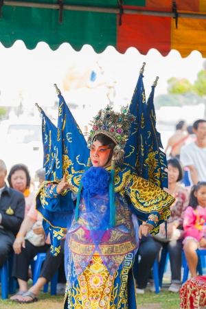 BANGKOK,THAILAND- NOVEMBER 28: Chinese opera dancers was showing the dance on King Taksin day who liberating Siam at Wat Aroonratchawararam temple on December 28,2012 in Bangkok,Thailand  Stock Photo - 18222558