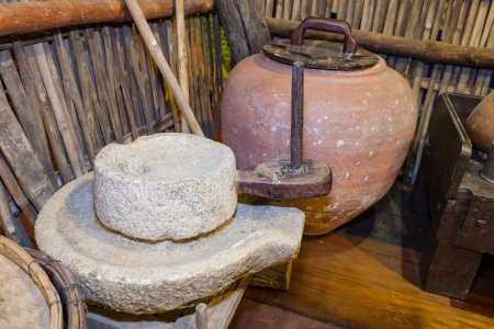 rice mill: Traditional ancient millstone which used for mill the rice to be rice powder or drug  Stock Photo