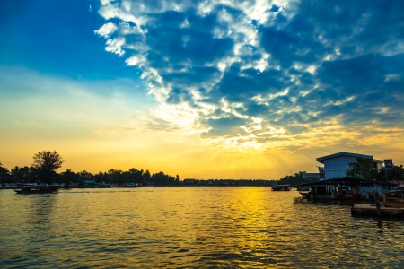 The beautiful evening sunset at Bangpakong river at Umpawa floating market in Thailand   photo