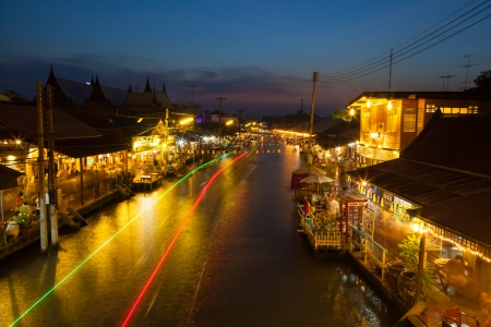 SUMUTHSONGKRAM,THAILAND-DECEMBER 30:Beautiful evening with twilight background called Ampawa floating market is the famous place to visit in Thailand on December 30,2012 in Samuthsongkram,Thailand
